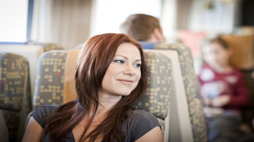 A woman travels in Canada by train